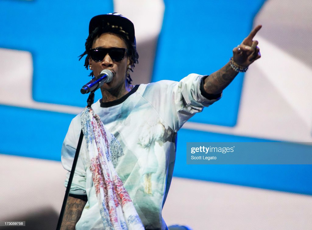 <a gi-track='captionPersonalityLinkClicked' href=/galleries/search?phrase=Wiz+Khalifa&family=editorial&specificpeople=7183449 ng-click='$event.stopPropagation()'>Wiz Khalifa</a> performs during the Quebec Festival D'ete on July 5, 2013 in Quebec City, Canada.