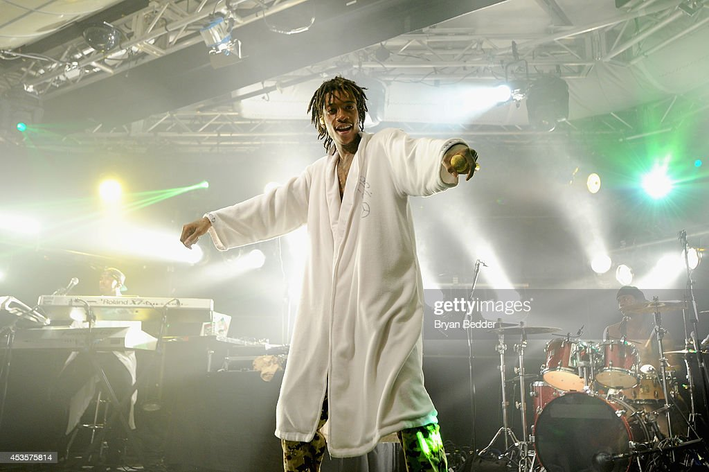 <a gi-track='captionPersonalityLinkClicked' href=/galleries/search?phrase=Wiz+Khalifa&family=editorial&specificpeople=7183449 ng-click='$event.stopPropagation()'>Wiz Khalifa</a> performs onstage at the iHeartRadio Live P.C. Richard & Son Theater on August 13, 2014 in New York City.