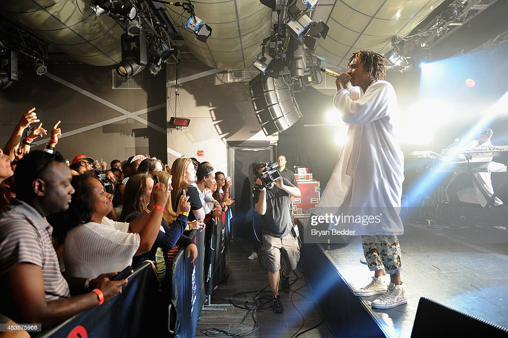Wiz Khalifa performs onstage at the iHeartRadio Live P.C. Richard & Son Theater on August 13, 2014 in New York City.