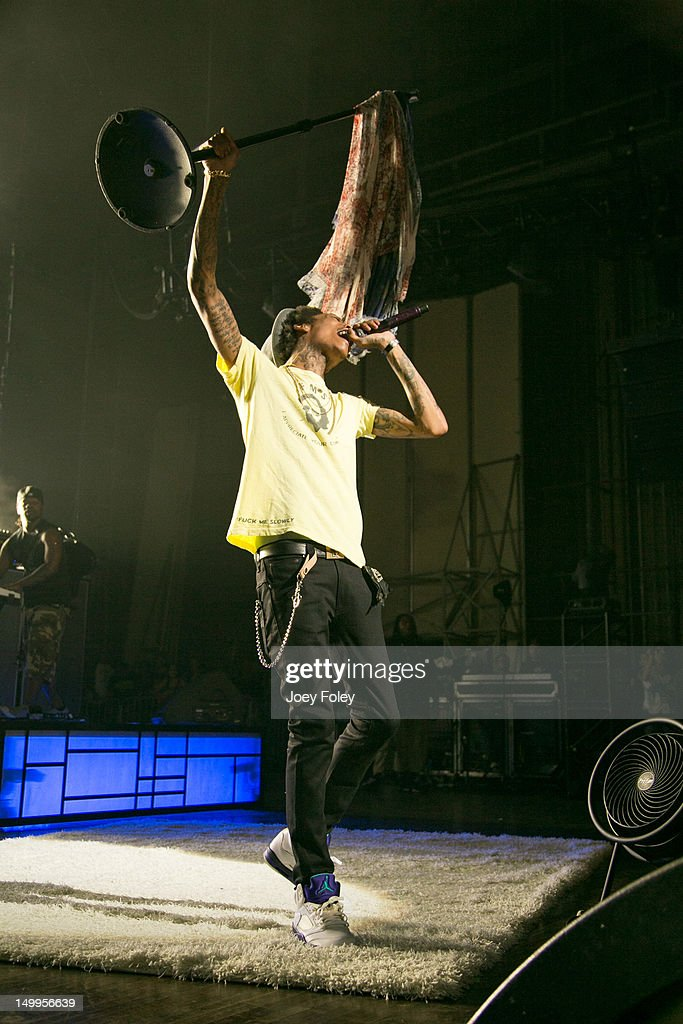 <a gi-track='captionPersonalityLinkClicked' href=/galleries/search?phrase=Wiz+Khalifa&family=editorial&specificpeople=7183449 ng-click='$event.stopPropagation()'>Wiz Khalifa</a> performs onstage during the opening night of the 'Under the Influence Tour' at Riverbend Music Center on July 26, 2012 in Cincinnati, Ohio.