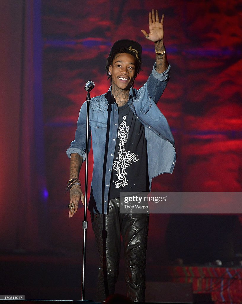 <a gi-track='captionPersonalityLinkClicked' href=/galleries/search?phrase=Wiz+Khalifa&family=editorial&specificpeople=7183449 ng-click='$event.stopPropagation()'>Wiz Khalifa</a> performs the Songwriters Hall of Fame 44th Annual Induction and Awards Dinner at the New York Marriott Marquis on June 13, 2013 in New York City.