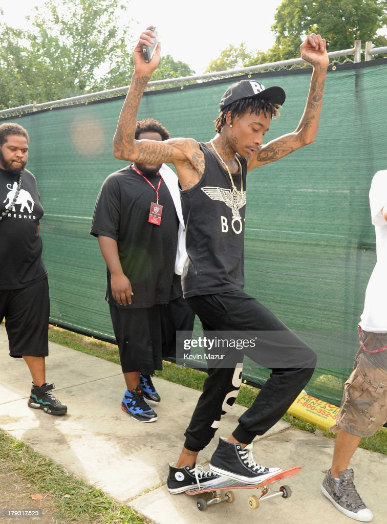 <a gi-track='captionPersonalityLinkClicked' href=/galleries/search?phrase=Wiz+Khalifa&family=editorial&specificpeople=7183449 ng-click='$event.stopPropagation()'>Wiz Khalifa</a> skateboards backstage during the 2013 Budweiser Made In America Festival at Benjamin Franklin Parkway on September 1, 2013 in Philadelphia, Pennsylvania.