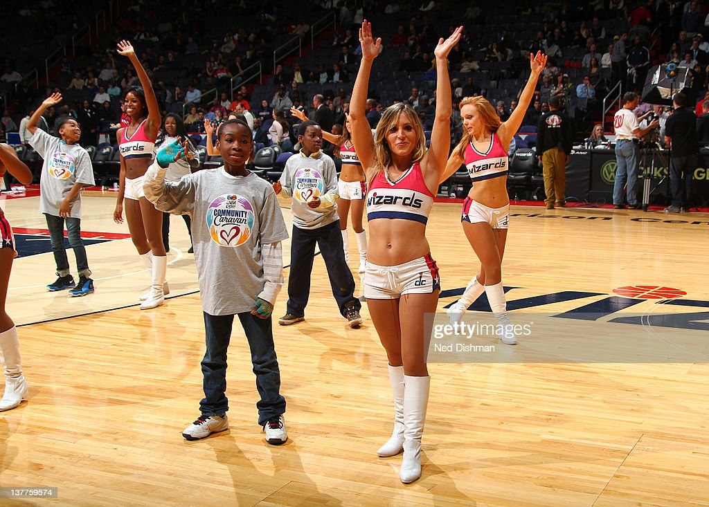 Wizard Girls and members of the community dance peform during half time of the Washington Wizards game against the Charlotte Bobcats on January 25, 2012 at the Verizon Center in Washington, DC.