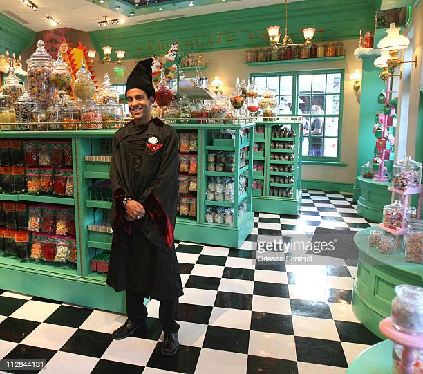 A wizard is ready to assist in the in the Honeydukes candy shop in Hogsmeade Village at the Wizarding World of Harry Potter at Universal's Islands of...