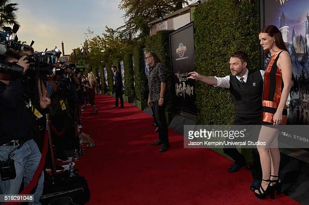 HOLLYWOOD 'Wizarding World of Harry Potter Attraction Opening' Pictured TV personality Chris Hardwick and actress Lydia Hearst arrive at the opening...
