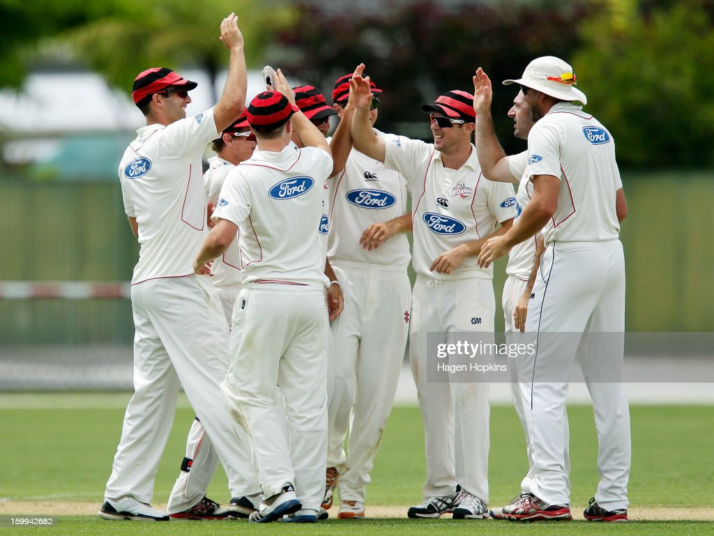 Wizards players celebrate the wicket of Carl Cachopa of the Stags during the Plunket Shield match between the Central Stags and the Cantebury Wizards at McLean Park on January 24, 2013 in Napier, New Zealand.