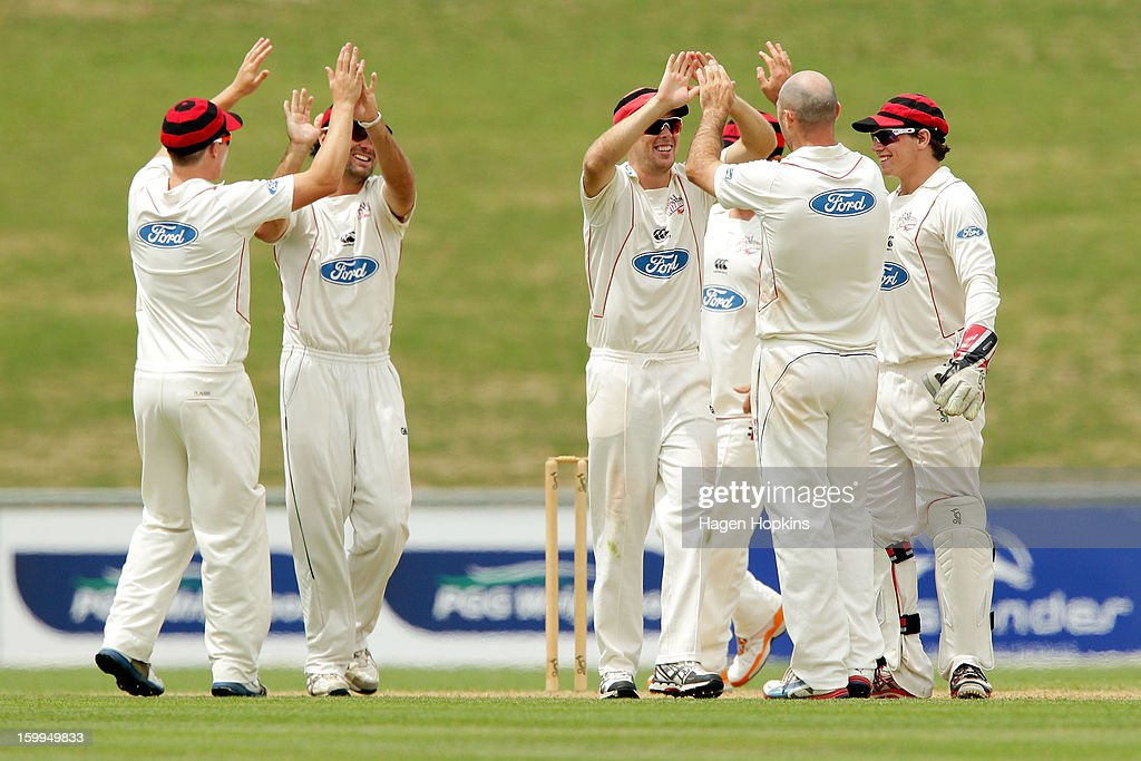 Wizards players celebrate the wicket of Jeet Raval of the Stags during the Plunket Shield match between the Central Stags and the Cantebury Wizards at McLean Park on January 24, 2013 in Napier, New Zealand.