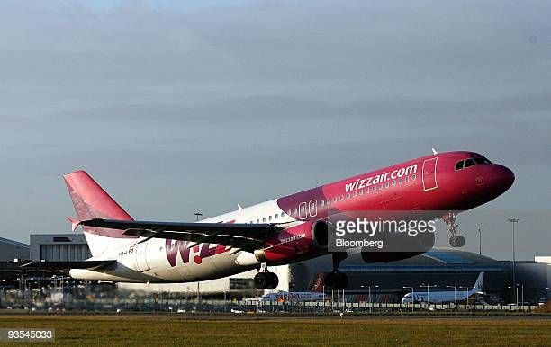 A Wizz Air jet takes off from the runway at Luton airport near Luton UK on Tuesday Dec1 2009 Pledges by China and the US to set numerical targets for...