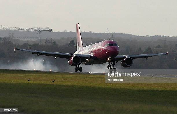 A Wizz Air jet touches down on the runway at Luton airport near Luton UK on Monday Nov 30 2009 Pledges by China and the US to set numerical targets...