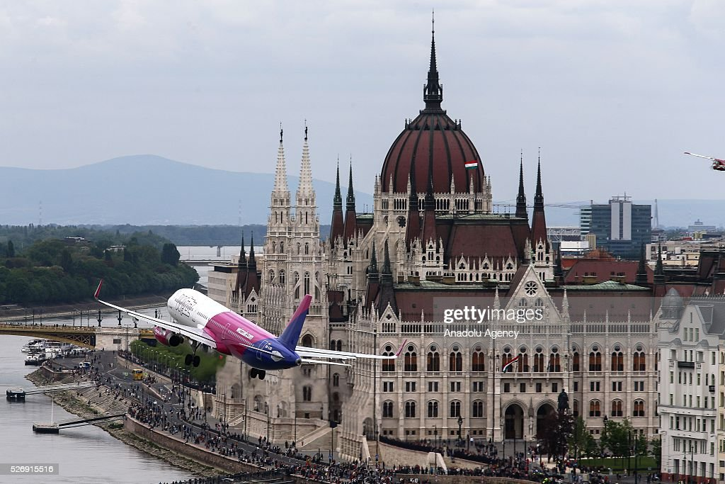 A Wizzair Airbus A-321 lowpasses over the Danube river during an air show in Budapest, Hungary on May 1, 2016