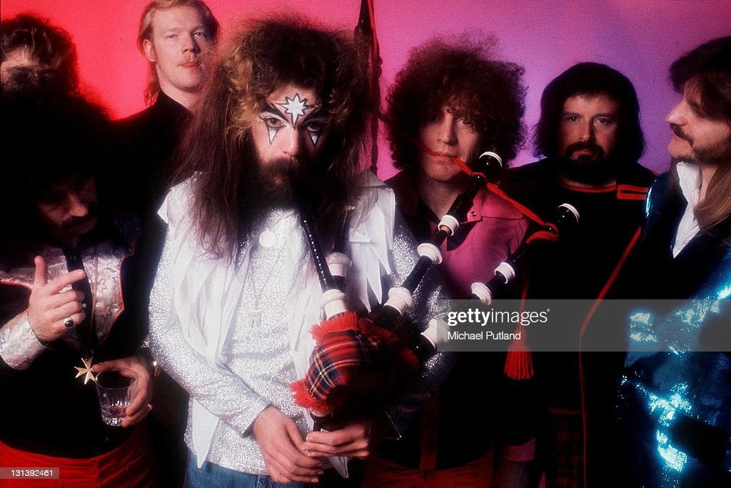 Wizzard, studio group portrait, 1974, Roy Wood centre with bagpipes.
