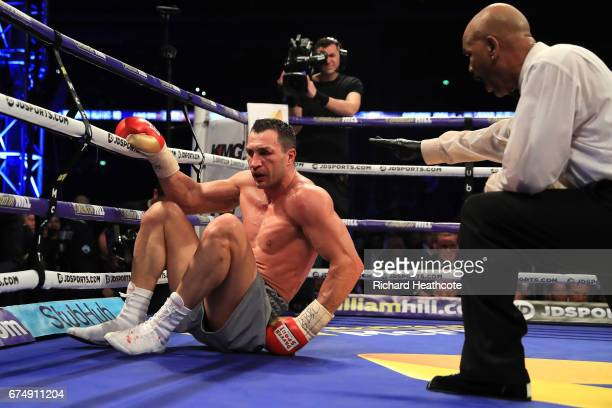 Wladamir Klitschko goes down against Anthony Joshua during the IBF WBA and IBO Heavyweight World Title bout at Wembley Stadium on April 29 2017 in...
