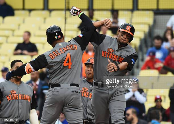 Wladimir Balentien and Xander Bogaerts of the Netherlands celebrate Balentien's 2run home run against team Puerto Rico in the first inning during...