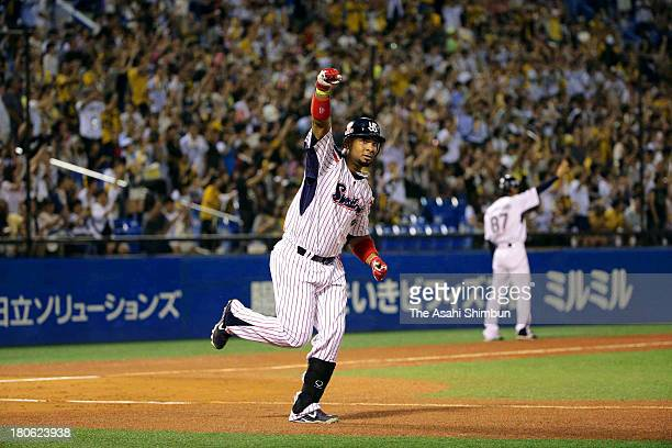 Wladimir Balentien of Yakult Swallows celebrates after hitting a tworun homer new record of 56th of the season in the bottom of first inning against...