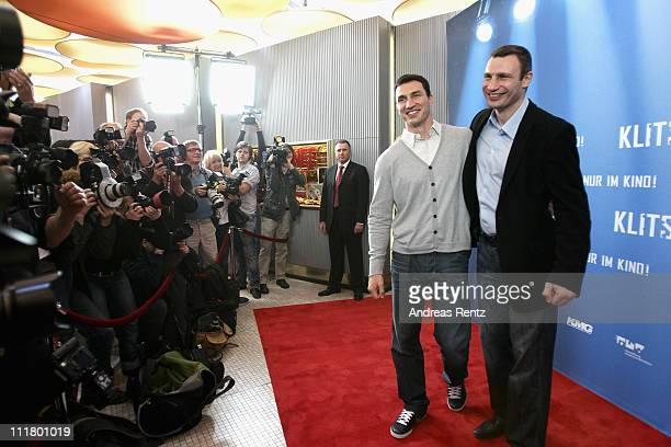 Wladimir Klitschko and his brother Vitali Klitschko attend a photocall to promote the 'Klitschko' documentary movie at Astor Film Lounge on April 7...