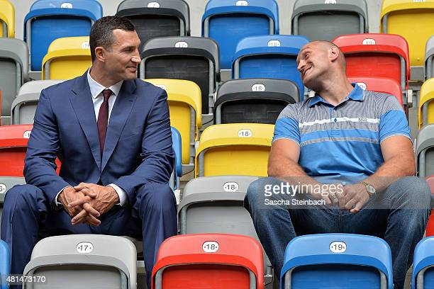 Wladimir Klitschko and Tyson Fury joke on the stand after a press conference at EspritArena on July 21 2015 in Duesseldorf Germany