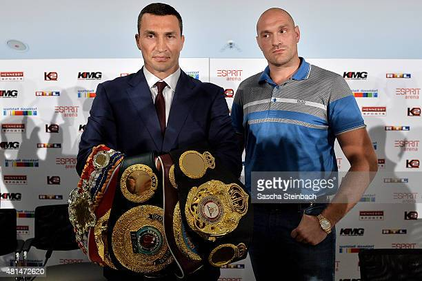 Wladimir Klitschko and Tyson Fury pose during a press conference at EspritArena on July 21 2015 in Duesseldorf Germany