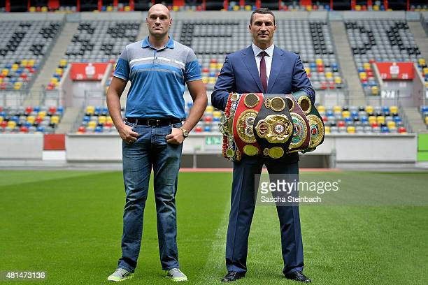 Wladimir Klitschko and Tyson Fury pose on the pitch after a press conference at EspritArena on July 21 2015 in Duesseldorf Germany