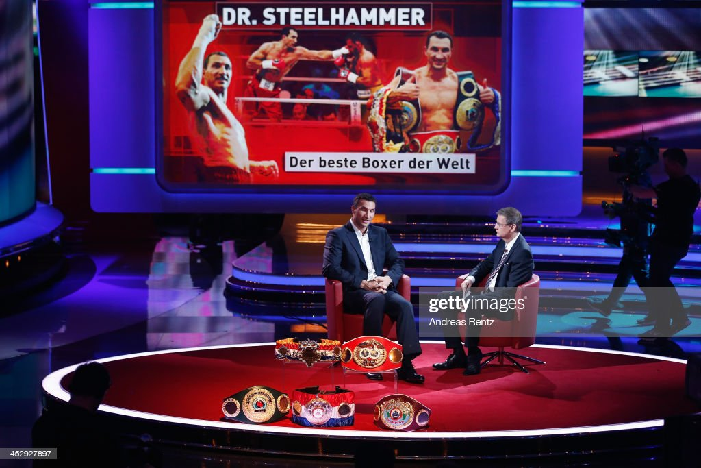 Wladimir Klitschko (L) chats with TV host Guenther Jauch during the '2013! Menschen, Bilder, Emotionen' - RTL-Jahresrueckblick on December 1, 2013 in Huerth near Cologne, Germany.