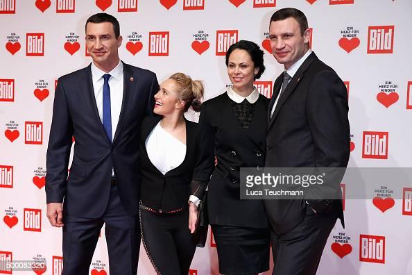 Wladimir Klitschko Hayden Panettiere Natalia Klitschko and Vitali Klitschko arrive for the Ein Herz Fuer Kinder Gala 2015 at Tempelhof Airport on...