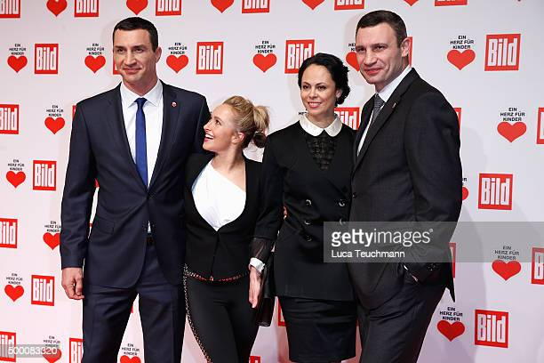 Wladimir Klitschko Hayden Panettiere Natalia Klitschko and Vitali Klitschko arrive for the Ein Herz Fuer Kinder Gala 2015 at Tempelhof Airport on...