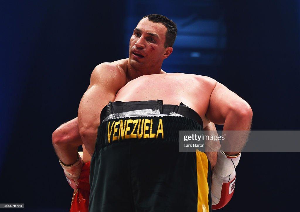 Wladimir Klitschko holds onto Tyson Fury during the IBF IBO WBA WBO Heavyweight World Championship contest at EspritArena on November 28 2015 in...