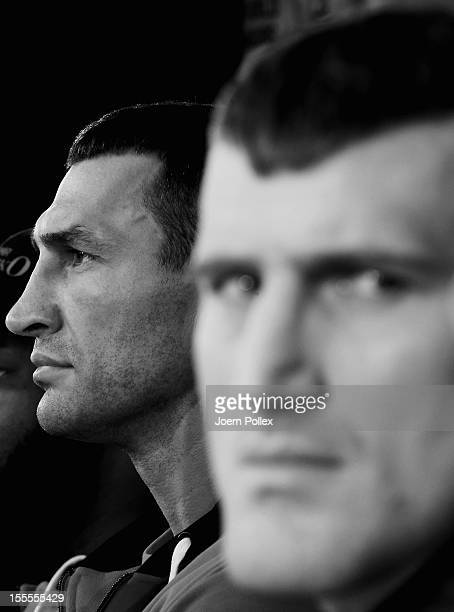 Wladimir Klitschko of Ukraine and Mariusz Wach of Poland are seen during a press conference ahead of their upcoming boxing fight at Google Hamburg on...