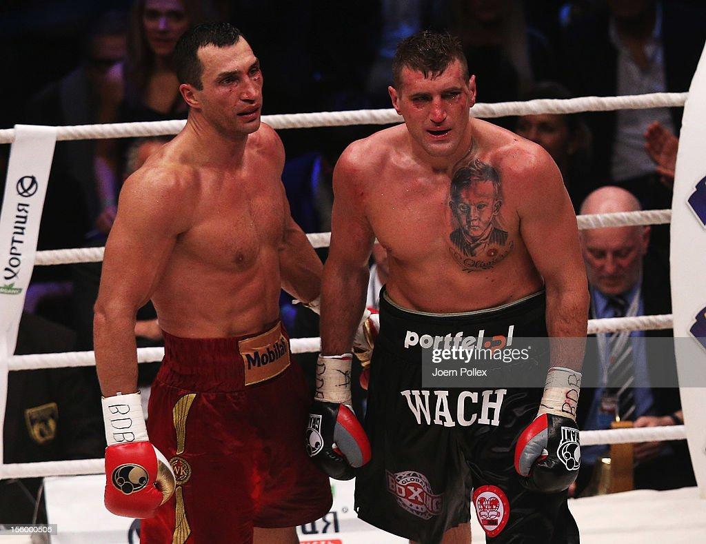 Wladimir Klitschko of Ukraine and Mariusz Wach of Poland are seen after the WBA IBF WBO and IBOheavy weight title fight between Wladimir Klitschko of...