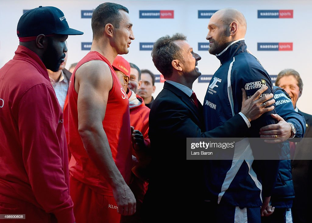 Wladimir Klitschko of Ukraine and Tyson Fury of UK are seen during the weigh in at Karstadt Sport on November 27, 2015 in Essen, Germany.