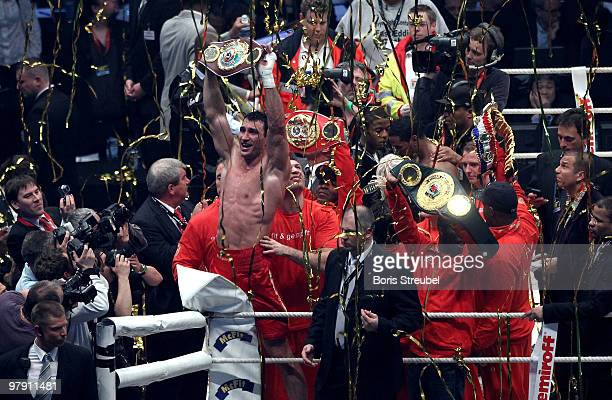 Wladimir Klitschko of Ukraine celebrates after winning the IBF WBO and IBO Heavyweight World Championship fight against Eddie Chambers of USA at the...