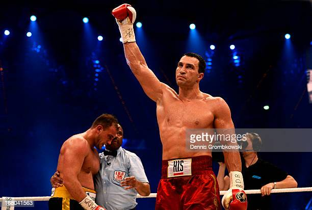 Wladimir Klitschko of Ukraine celebrates defeating Francesco Pianeta of Italy and retaining his IBF IBO WBA WBO titles after their World Championship...