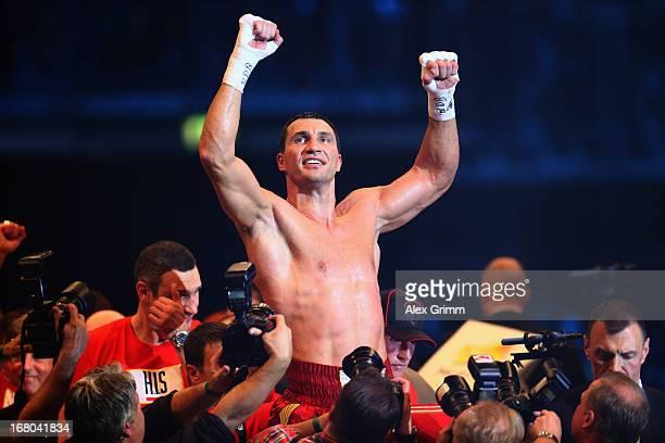 Wladimir Klitschko of Ukraine celebrates defeating Francesco Pianeta of Italy and retaining his IBF IBO WBA WBO titles after their World Championship...