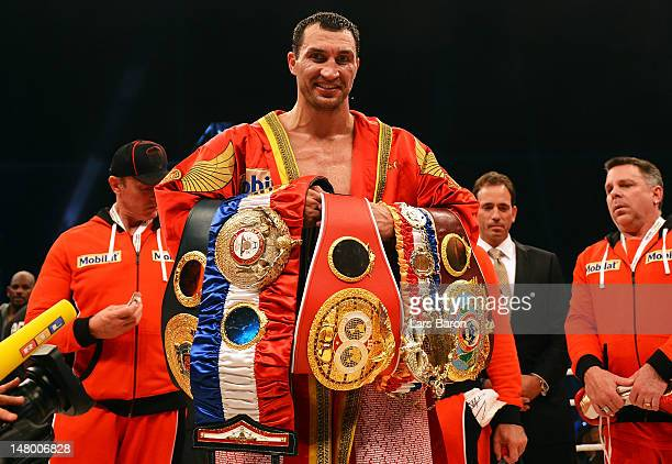 Wladimir Klitschko of Ukraine celebrates with his belts after winning the WBA IBF WBO and IBOheavy weight title fight between Wladimir Klitschko of...