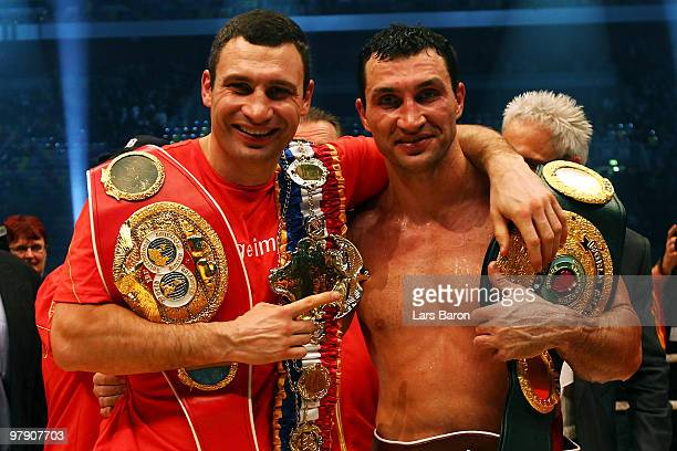Wladimir Klitschko of Ukraine celebrates with his brother Vitali Klitschko after winning his WBO Heavyweight World Championship fight against Eddie...