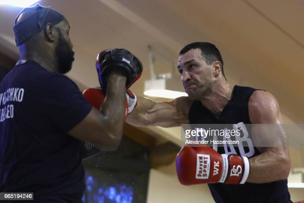 Wladimir Klitschko of Ukraine exchange punches with his head coach Johnathon Banks during a training session at Hotel Stanglwirt on April 6 2017 in...