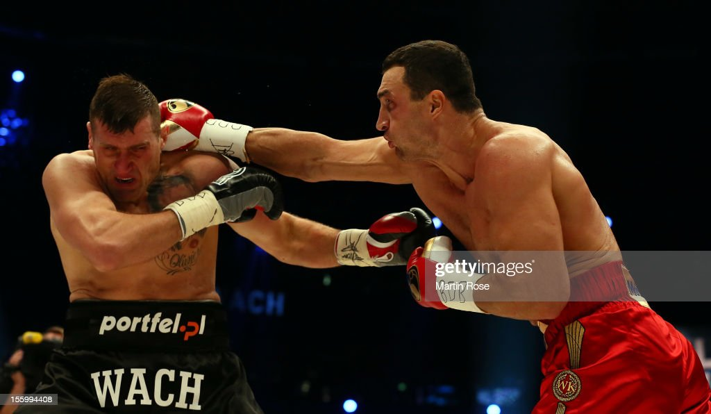 <a gi-track='captionPersonalityLinkClicked' href=/galleries/search?phrase=Wladimir+Klitschko&family=editorial&specificpeople=210650 ng-click='$event.stopPropagation()'>Wladimir Klitschko</a> (R) of Ukraine exchange punches with Mariusz Wach (L) of Poland during the WBA-, IBF,- WBO- and IBO-heavy weight title fight between <a gi-track='captionPersonalityLinkClicked' href=/galleries/search?phrase=Wladimir+Klitschko&family=editorial&specificpeople=210650 ng-click='$event.stopPropagation()'>Wladimir Klitschko</a> of Ukraine and Mariusz Wach of Poland at O2 World on November 10, 2012 in Hamburg, Germany.