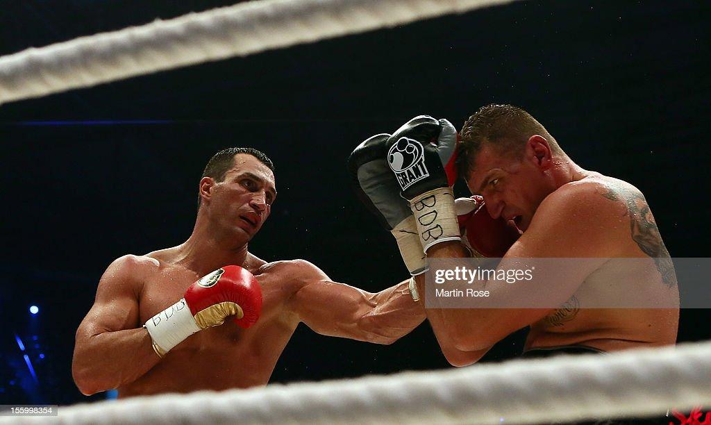 Wladimir Klitschko of Ukraine exchange punches with Mariusz Wach of Poland during the WBA IBF WBO and IBOheavy weight title fight between Wladimir...