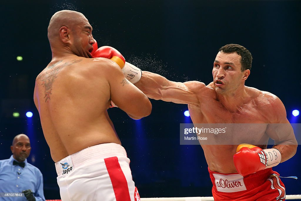 <a gi-track='captionPersonalityLinkClicked' href=/galleries/search?phrase=Wladimir+Klitschko&family=editorial&specificpeople=210650 ng-click='$event.stopPropagation()'>Wladimir Klitschko</a> (R) of Ukraine exchanges punches with <a gi-track='captionPersonalityLinkClicked' href=/galleries/search?phrase=Alex+Leapai&family=editorial&specificpeople=7461038 ng-click='$event.stopPropagation()'>Alex Leapai</a> (L) of Australia during their WBO, WBA, IBF and IBO heavy weight title fight between <a gi-track='captionPersonalityLinkClicked' href=/galleries/search?phrase=Wladimir+Klitschko&family=editorial&specificpeople=210650 ng-click='$event.stopPropagation()'>Wladimir Klitschko</a>at and Alex Lepai at Koenig-Pilsner Arena on April 26, 2014 in Oberhausen, Germany.