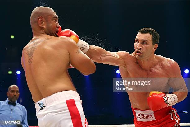 Wladimir Klitschko of Ukraine exchanges punches with Alex Leapai of Australia during their WBO WBA IBF and IBO heavy weight title fight between...