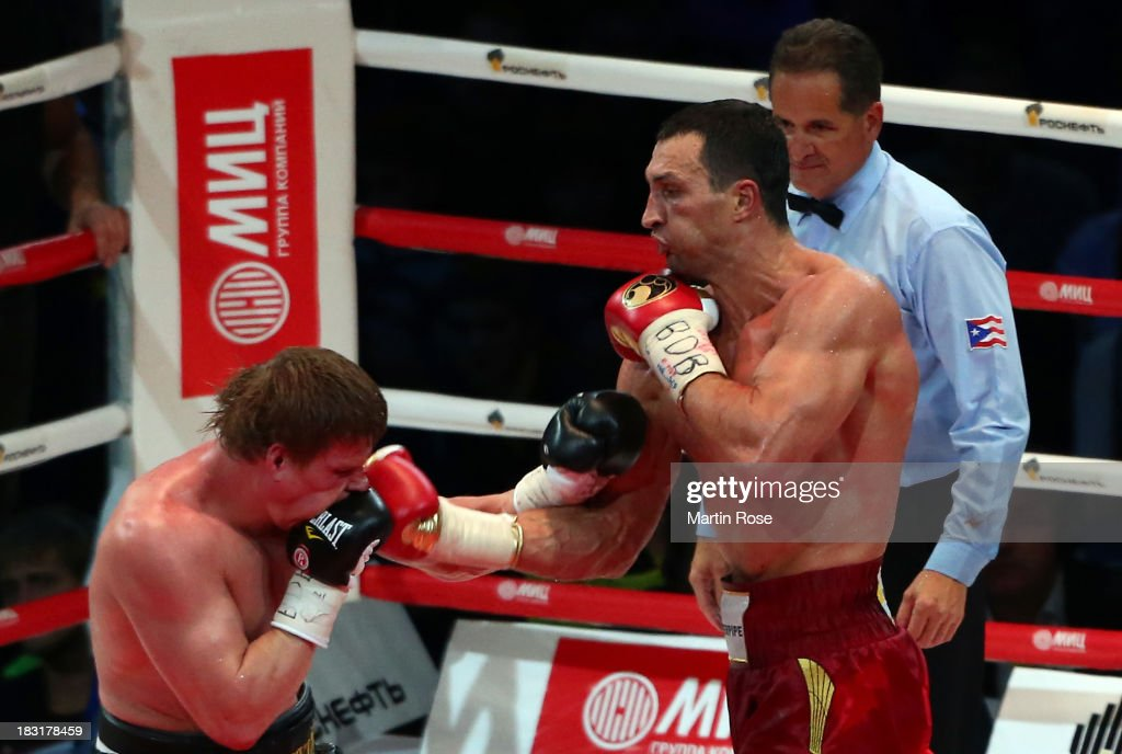 <a gi-track='captionPersonalityLinkClicked' href=/galleries/search?phrase=Wladimir+Klitschko&family=editorial&specificpeople=210650 ng-click='$event.stopPropagation()'>Wladimir Klitschko</a> (R) of Ukraine exchanges punches with <a gi-track='captionPersonalityLinkClicked' href=/galleries/search?phrase=Alexander+Povetkin&family=editorial&specificpeople=2351769 ng-click='$event.stopPropagation()'>Alexander Povetkin</a> (L) of Russia during their WBO, WBA, IBF and IBO heavy weight title fight between <a gi-track='captionPersonalityLinkClicked' href=/galleries/search?phrase=Wladimir+Klitschko&family=editorial&specificpeople=210650 ng-click='$event.stopPropagation()'>Wladimir Klitschko</a> and <a gi-track='captionPersonalityLinkClicked' href=/galleries/search?phrase=Alexander+Povetkin&family=editorial&specificpeople=2351769 ng-click='$event.stopPropagation()'>Alexander Povetkin</a> of Russia at Olimpiyskiy Arena on October 5, 2013 in Moscow, Russia.