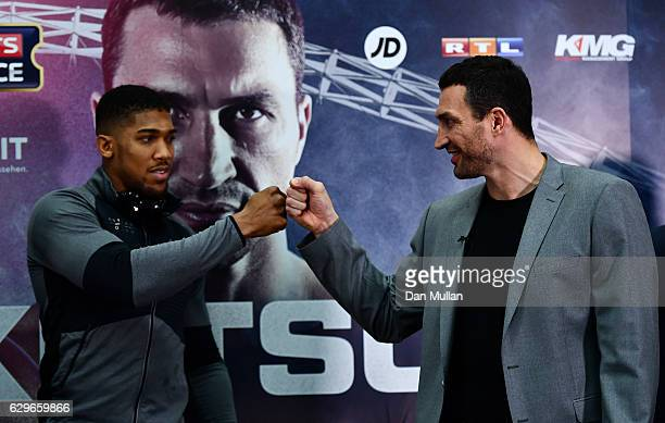 Wladimir Klitschko of Ukraine greets Anthony Joshua of Great Britain during a press conference at Wembley Stadium on December 14 2016 in London...