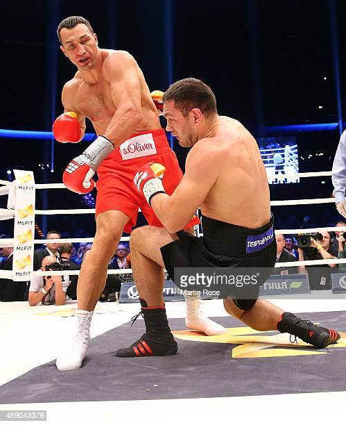 Wladimir Klitschko of Ukraine knocks Kubrat Pulev of Bulgaria down during their IBF heavy weight title fight between Wladimir Klitschkoat and Kubrat...