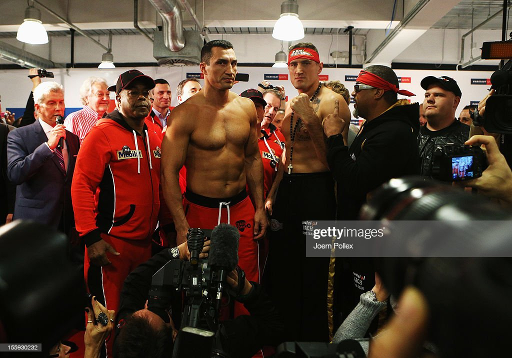 Wladimir Klitschko of Ukraine looks to Mariusz Wach of Poland during the weigh in at Karstadt Sport on November 9 2012 in Hamburg Germany The WBA IBF...