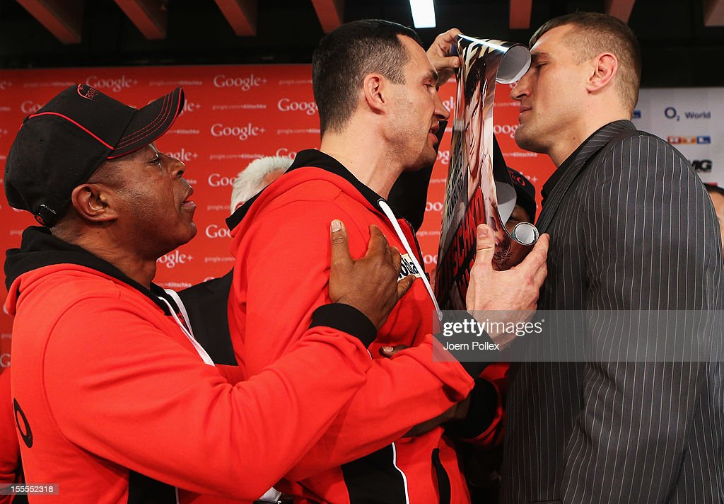 Wladimir Klitschko of Ukraine pose on a head to head with Mariusz Wach during a press conference with Wladimir Klitschko and Mariusz Wach ahead of...