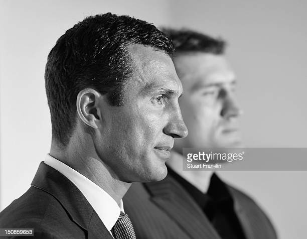 Wladimir Klitschko of Ukraine poses for a photograph with Mariusz Wach of Poland after a press conference with Wladimir Klitschko and Mariusz Wach...