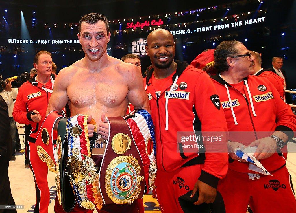 Wladimir Klitschko of Ukraine poses with the trophy after winning the WBA IBF WBO and IBOheavy weight title fight between Wladimir Klitschko of...