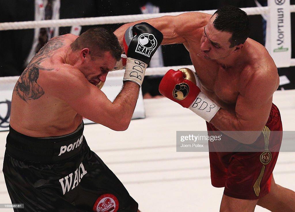 Wladimir Klitschko of Ukraine punches Mariusz Wach of Poland box during the WBA IBF WBO and IBOheavy weight title fight between Wladimir Klitschko of...