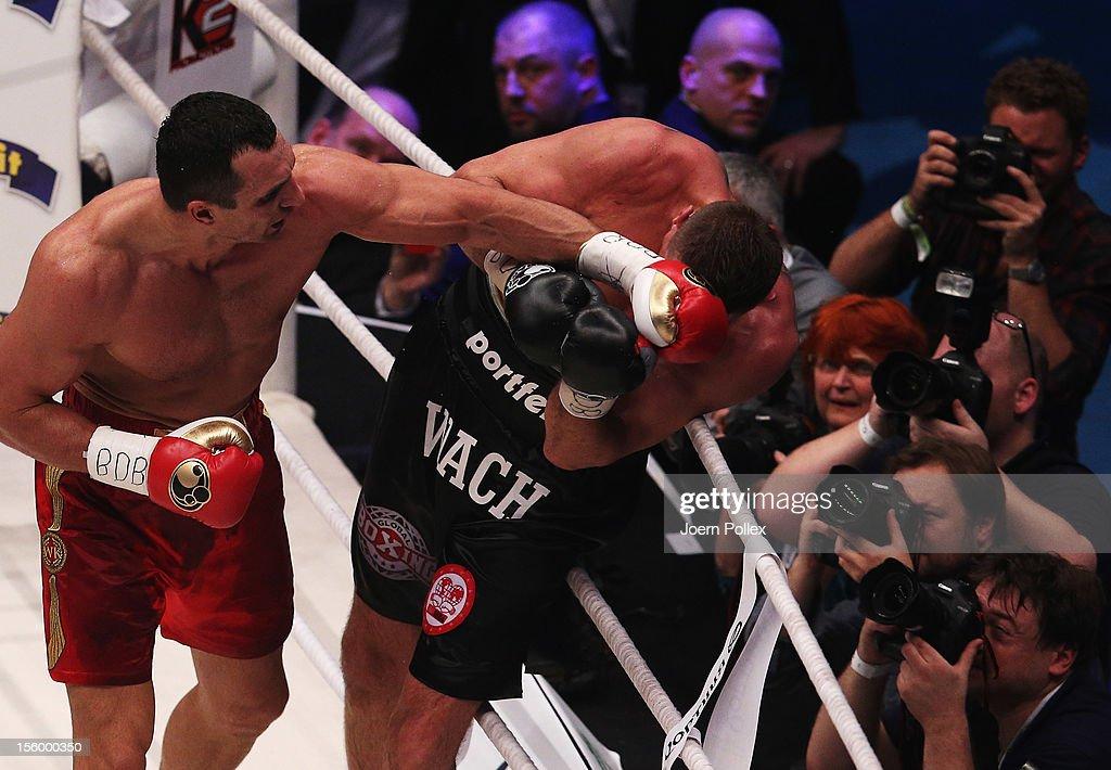 Wladimir Klitschko of Ukraine punches Mariusz Wach of Poland during the WBA IBF WBO and IBOheavy weight title fight between Wladimir Klitschko of...