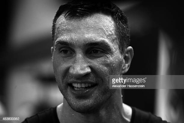 Wladimir Klitschko of Ukraine smiles after a training session at Hotel Stanglwirt on August 19 2014 in Going Austria Wladimir Klitschko will defend...