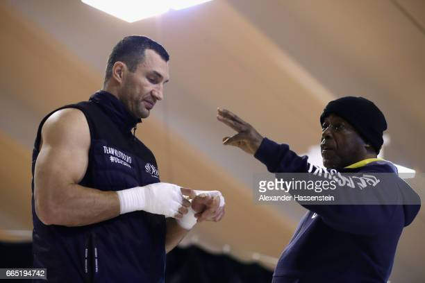 Wladimir Klitschko of Ukraine talks to his assistant coach James Ali Bashir during a training session at Hotel Stanglwirt on April 6 2017 in Going...